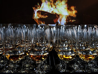 Photograph of a flaming whisky glass from a ScotchBrothEvents taste event